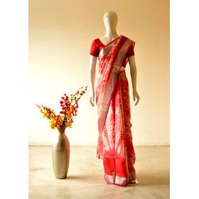 Linen saree with silver zari border and all over batik prints